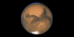 Mars - By NASA, ESA, and The Hubble Heritage Team (STScI/AURA) [Public domain], via Wikimedia Commons